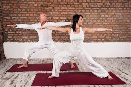 Couple Practising Yoga Stock Photo - Premium Royalty-Free, Code: 6115-06778895