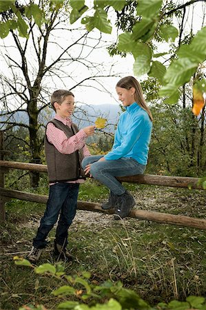 preteen girl boyfriends - Two Children, Girl Sitting On Fence, Bavaria, Germany, Europe Stock Photo - Premium Royalty-Free, Code: 6115-06778802