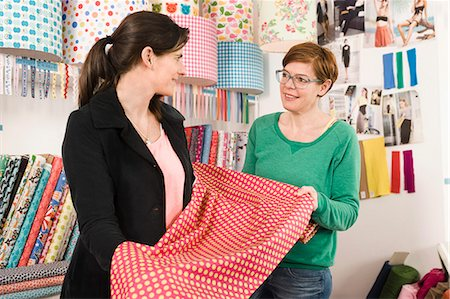 Women In A Shop Choosing Fabric, Munich, Bavaria, Germany, Europe Stock Photo - Premium Royalty-Free, Code: 6115-06778830