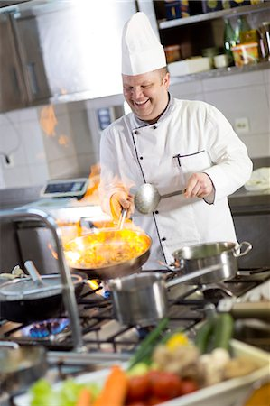 flame - Chef flambeing food in pan Stock Photo - Premium Royalty-Free, Code: 6115-06778981