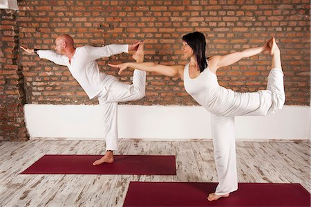 flexible (people or objects with physical bendability) - Couple In Yoga Pose Stock Photo - Premium Royalty-Free, Code: 6115-06778907