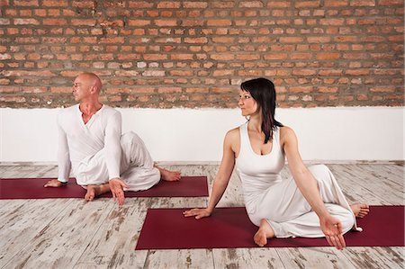 flexible (people or objects with physical bendability) - Couple Practising Yoga Stock Photo - Premium Royalty-Free, Code: 6115-06778904