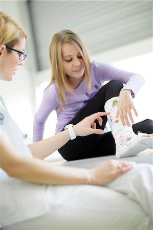 Female doctor pointing at girl's leg in plaster, Osijek, Croatia Stock Photo - Premium Royalty-Free, Code: 6115-06778933
