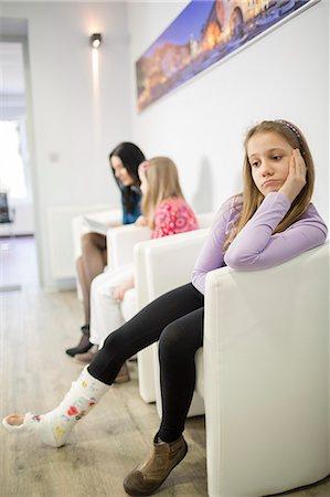 doctor in waiting room - Girl in waiting room, two people in background, Osijek, Croatia Stock Photo - Premium Royalty-Free, Code: 6115-06778937