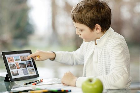 preteens fingering - Boy using digital tablet, Osijek, Croatia, Europe Stock Photo - Premium Royalty-Free, Code: 6115-06779067