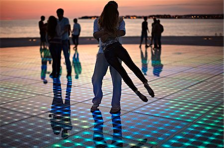 Croatia, Dalmatia, Solar panels as a dance floor, sunset in background Stock Photo - Premium Royalty-Free, Code: 6115-06732879