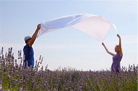 smelly - Young Couple Spreading Blanket In Lavender Field, Croatia, Dalmatia, Europe Stock Photo - Premium Royalty-Free, Code: 6115-06732999