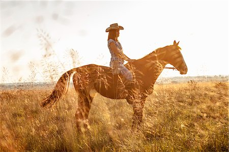 Croatia, Dalmatia, Young woman horseback riding Stock Photo - Premium Royalty-Free, Code: 6115-06733073