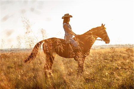 Croatia, Dalmatia, Young woman horseback riding Stock Photo - Premium Royalty-Free, Code: 6115-06733073