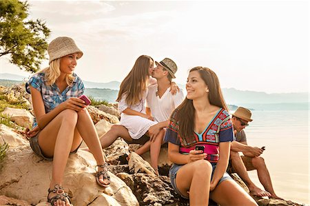 Croatia, Dalmatia, Young people at the seaside, using phones Stock Photo - Premium Royalty-Free, Code: 6115-06733080
