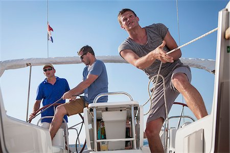 sailboat  ocean - Croatia, Adriatic Sea, Young men on sailboat Stock Photo - Premium Royalty-Free, Code: 6115-06733143