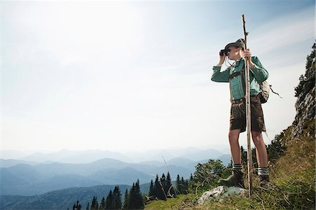 Germany, Bavaria, Boy looking through binoculars in the mountains Stock Photo - Premium Royalty-Free, Code: 6115-06733162