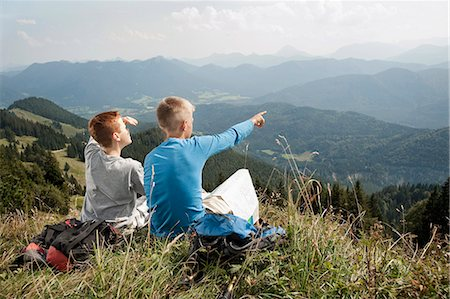 sitting - Germany, Bavaria, Two boys in mountains taking a view Stock Photo - Premium Royalty-Free, Code: 6115-06733171