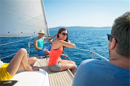 sailboat  ocean - Croatia, Adriatic Sea, Young people on sailboat relaxing Stock Photo - Premium Royalty-Free, Code: 6115-06733126