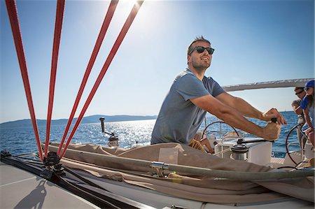 sailboat  ocean - Croatia, Adriatic Sea, Young man on sailboat Stock Photo - Premium Royalty-Free, Code: 6115-06733134