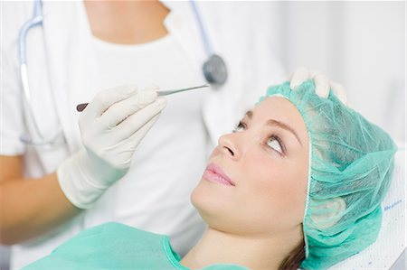 facial - Patient Getting A Cosmetic Surgery Treatment Stock Photo - Premium Royalty-Free, Code: 6115-06733252