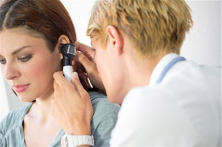 practise - ENT physician Examining the Ear from Female Patient Stock Photo - Premium Royalty-Free, Code: 6115-06733201