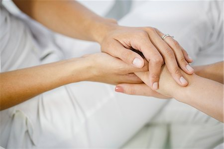 Doctor's Visit, Holding Hands, Close-up Stock Photo - Premium Royalty-Free, Code: 6115-06733210