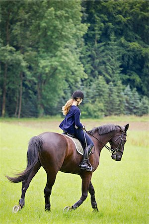 Woman Riding Horse in Rural Landscape, Baden Wuerttemberg, Germany, Europe Stock Photo - Premium Royalty-Free, Code: 6115-07109619