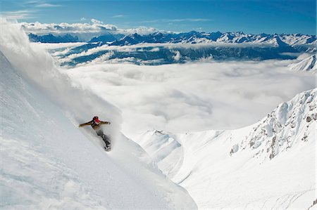 sports and snowboarding - Snowboarder takes a powder turn, Innsbruck, Austria Stock Photo - Premium Royalty-Free, Code: 6115-07109803