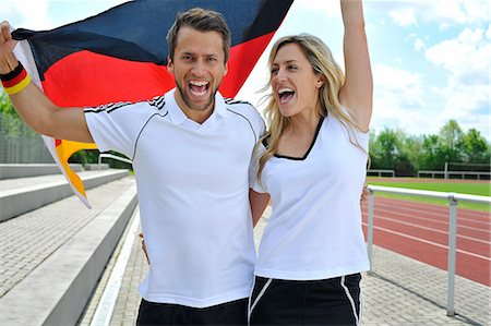 passion - Soccer fans waving German flag, Munich, Bavaria, Germany Stock Photo - Premium Royalty-Free, Code: 6115-07109915