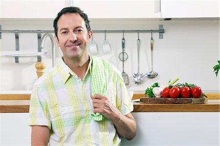 Man In Kitchen Stock Photo - Premium Royalty-Free, Code: 6115-07282674