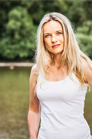 Young woman in a white shirt, portrait, Bavaria, Germany Stock Photo - Premium Royalty-Free, Code: 6115-07282773