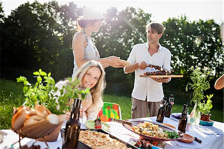Friends barbecuing on the riverside, foothills of the Alps, Bavaria, Germany Stock Photo - Premium Royalty-Free, Code: 6115-07282778