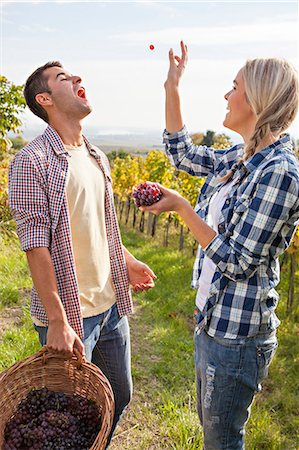 Grape harvest, Young couple having fun, Slavonia, Croatia Stock Photo - Premium Royalty-Free, Code: 6115-07282879