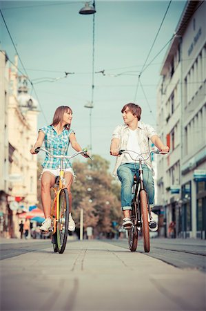 Young couple riding bicycles together, Osijek, Croatia Stock Photo - Premium Royalty-Free, Code: 6115-07282896
