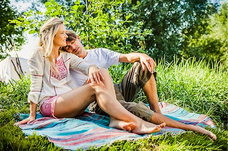 Young couple relaxes on the riverside, foothills of the Alps, Bavaria, Germany Stock Photo - Premium Royalty-Free, Code: 6115-07282800