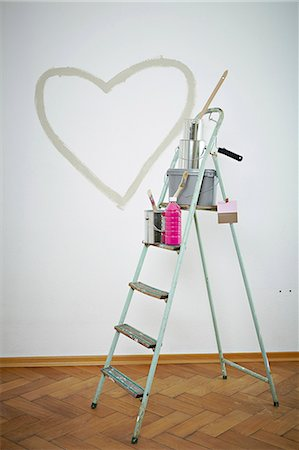 Painting equipment on a ladder, heart shape on wall, Munich, Bavaria, Germany Stock Photo - Premium Royalty-Free, Code: 6115-07282815