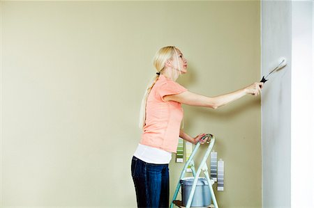 painting - Woman painting the wall, color samples in background, Munich, Bavaria, Germany Stock Photo - Premium Royalty-Free, Code: 6115-07282824