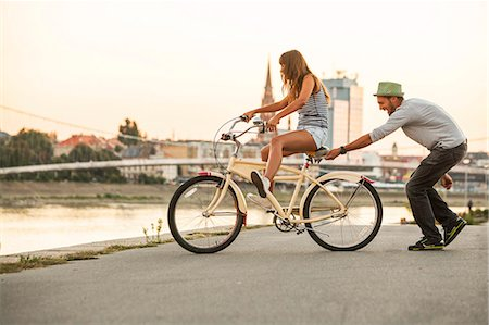fun - Young couple with bicycle, having fun, Osijek, Croatia Stock Photo - Premium Royalty-Free, Code: 6115-07282907