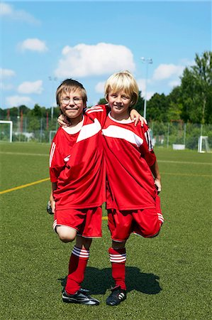 football team - Two boys at soccer training, side by side, Munich, Germany Stock Photo - Premium Royalty-Free, Code: 6115-07539643