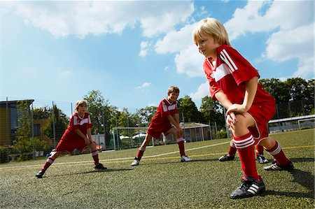 football team - Group of boys at soccer training, stretching, Munich, Germany Stock Photo - Premium Royalty-Free, Code: 6115-07539642