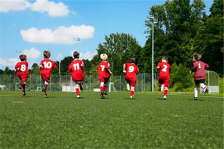 football team - Group of boys at soccer training, running side by side, Munich, Bavaria, Germany Stock Photo - Premium Royalty-Free, Code: 6115-07539647
