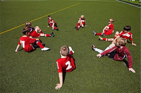 football team - Group of boys at soccer training, stretching, Munich, Bavaria, Germany Stock Photo - Premium Royalty-Free, Code: 6115-07539644