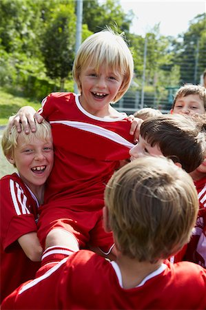 football team - Group of boys at soccer training, cheering, Munich, Bavaria, Germany Stock Photo - Premium Royalty-Free, Code: 6115-07539654