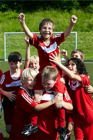football team - Group of boys at soccer training, cheering, Munich, Bavaria, Germany Stock Photo - Premium Royalty-Free, Code: 6115-07539655