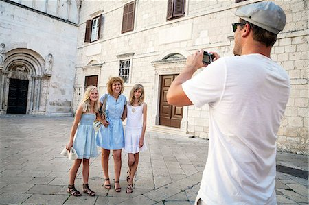 Man taking a picture of his family, Zadar, Croatia Stock Photo - Premium Royalty-Free, Code: 6115-07539659