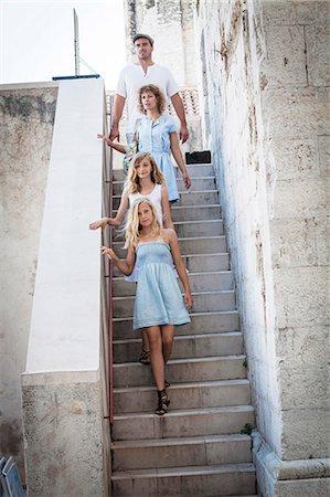 Family climbing down stairs, in a row, Zadar, Croatai Stock Photo - Premium Royalty-Free, Code: 6115-07539661