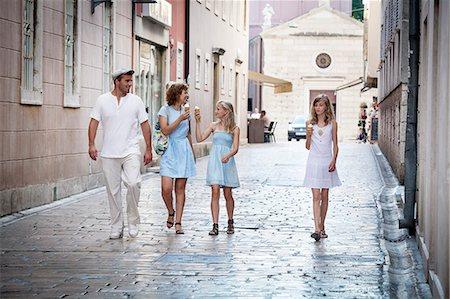 Family takes a walk, eating ice cream, Zadar, Croatia Stock Photo - Premium Royalty-Free, Code: 6115-07539662