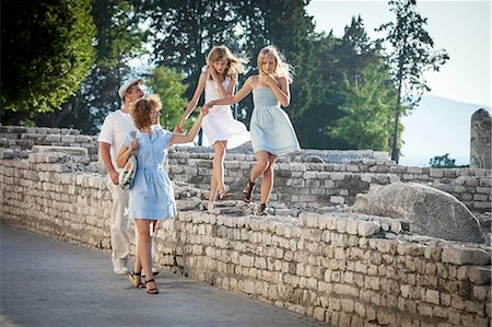 Family takes a walk through Old Town ruins, Zadar, Croatia Stock Photo - Premium Royalty-Free, Code: 6115-07539664