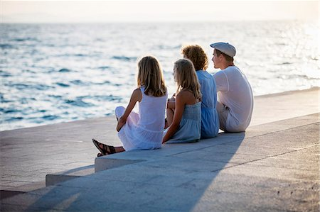 europe - Family on boardwalk, looking at sea, Zadar, Croatia Stock Photo - Premium Royalty-Free, Code: 6115-07539666