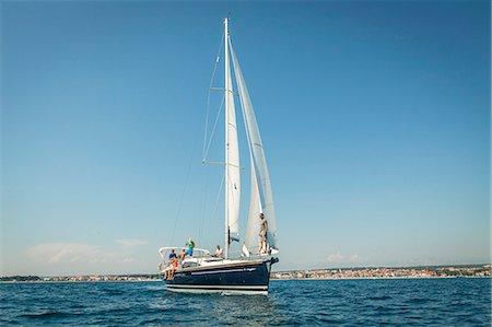 sailboat  ocean - Young people sailing together, Adriatic Sea, Croatia Stock Photo - Premium Royalty-Free, Code: 6115-07539682