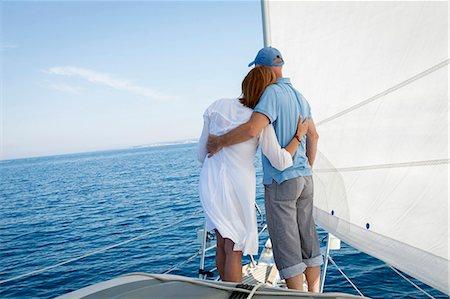 sailboat  ocean - Mature couple on sailboat, looking at view, Adriatic Sea, Croatia Stock Photo - Premium Royalty-Free, Code: 6115-07539698