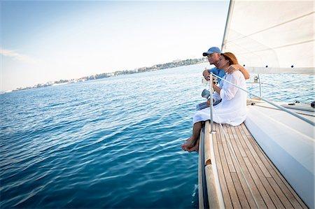 sailboat  ocean - Mature couple on sailboat, relaxing, Adriatic Sea, Croatia Stock Photo - Premium Royalty-Free, Code: 6115-07539699