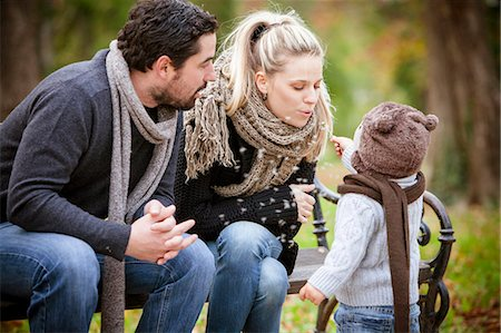 Family with son sitting on a park bench, Osijek, Croatia Stock Photo - Premium Royalty-Free, Code: 6115-07539774