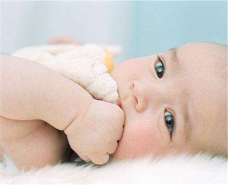 Baby Boy Chewing On Comfort Blanket, Munich, Bavaria, Germany, Europe Stock Photo - Premium Royalty-Free, Code: 6115-07539737